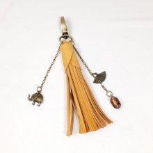 Bijou de sac pompon cuir vachette orange et perle style Murano